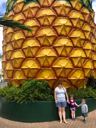 Cara and the kids standing in front of The Big Pineapple.
